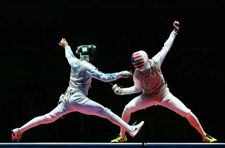 RIO DE JANEIRO, BRAZIL - AUGUST 07: Daniele Garozzo (L) of Italy competes with Alexander Massialas (R) of the United States on his way to winning the Men's Individual Foil Final on Day 2 of the Rio 2016 Olympic Games at Carioca Arena 3 on August 7, 2016 in Rio de Janeiro, Brazil. (Photo by Alex Livesey/Getty Images)