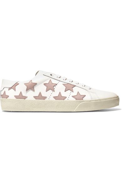 Saint Laurent's sneakers are made from smooth leather in a classic low-top shape. This pair is appliquéd with pale-pink stars and has a textured rubber sole. We think they work best with tapered or rolled jeans.