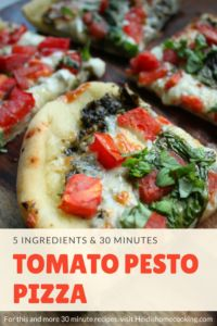 Tomato Pesto Pizza is an easy family dinner that can be ready in 30 minutes or less! It can be made with a store bought dough, but if you prefer homemade crust, there are instructions for how to make your own pizza dough. The pizza is bursting with fresh flavors, all for less than ten dollars. That makes this a delicious and budget friendly meal!