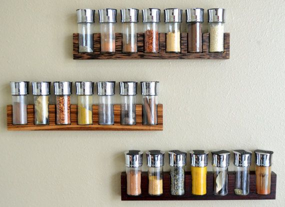 These minimalist spice racks are a perfect way to showcase the wonderful colors of spices as well as the unique grain and color variations
