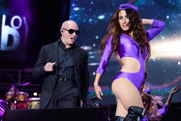 "Pitbull has received criticism in the past over the way women are depicted in his songs and music videos. | DJ Sara Cox Says Pitbull Makes Her ""Soul Weep"" Due To The Way He Sings About Women"