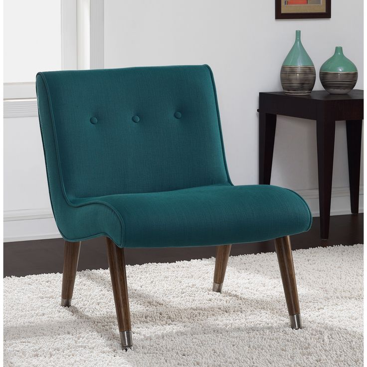 You'll love the minimalist appeal of this Mid Century armless chair. Upholstered in an elegant teal fabric, this chair is complete with rich medium walnut legs and capped with nickel feet.