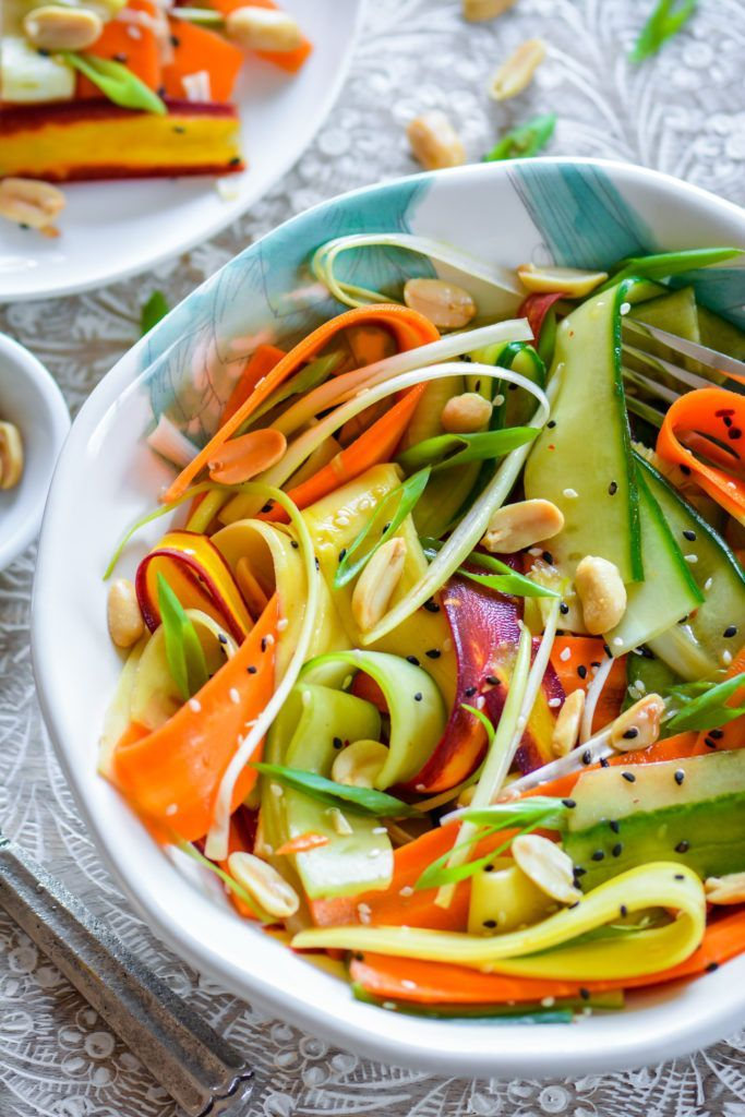 Every fork full of this Asian Ribbon Salad has something delicious to offer! Ribbons of crunchy rainbow carrots, refreshing cucumber, nutty peanuts, and sweet and sour sesame-soy dressing! What's not to love?
