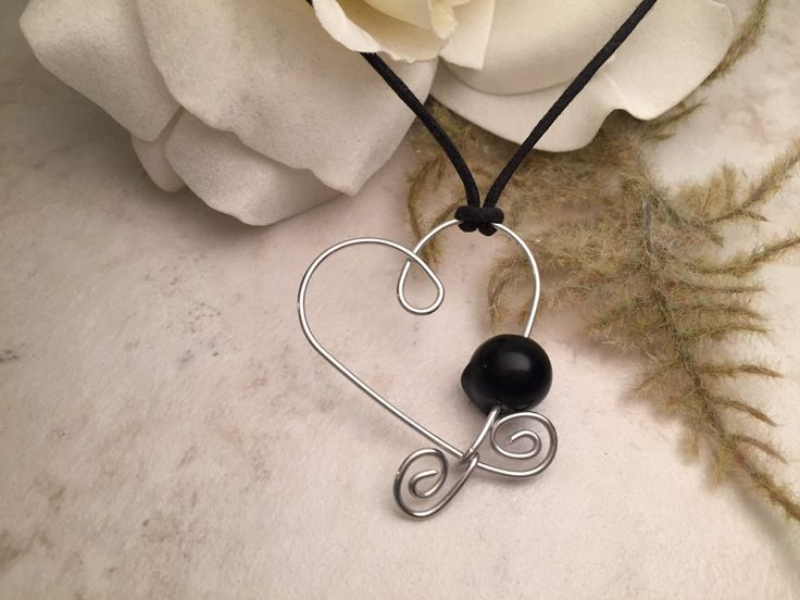 Silver Wire Heart Black Beaded Necklace by TCbyRachel on Etsy https://www.etsy.com/listing/120386543/silver-wire-heart-black-beaded-necklace