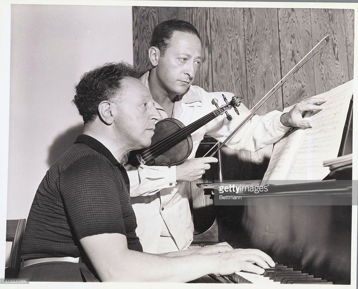 Violinist Jascha Heifetz and pianist Arthur Rubinstein practice for a concert in aid of British War Relief and the Royal Air Force Benevolent Fund.