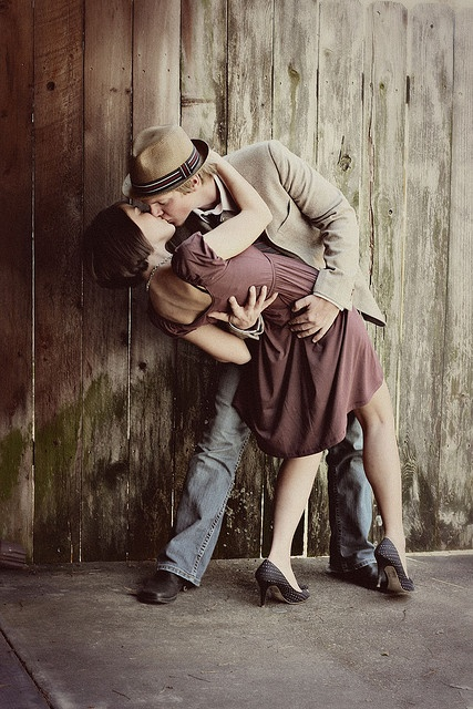 Old fashion photo of a cute couple madly in love, kissing passionately. (https://ToolBoxForCouples.com)