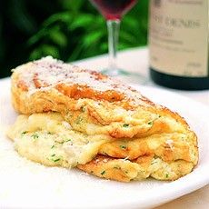 a souffle omelette with three cheeses and chives.