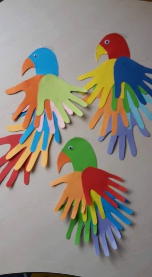 Colorful birds, done with handprints.