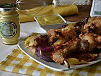Coniglio alla senape, dorato e gustoso cotto al forno