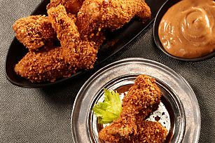 No one will want to pass on this simply satisfying snack – RITZ Crispy-Coated Chicken Wings with Playbook Sauce.