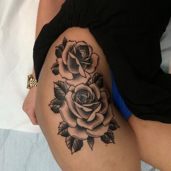 Great big rose flowers tattoo on thigh