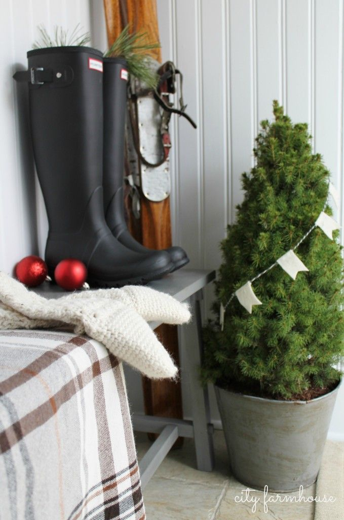 City Farmhouse: potted mini tree // plaid IKEA throw // felt notched pennant garland on grey + cream baker's twine-style yarn