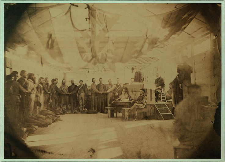 Confederate prisoners taking the oath of allegiance at Point Lookout, MD.