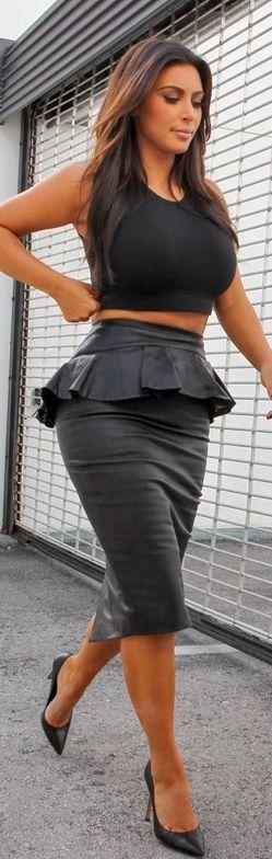 Kim Kardashian: Skirt – Alexander McQueen  Shirt – Wolford