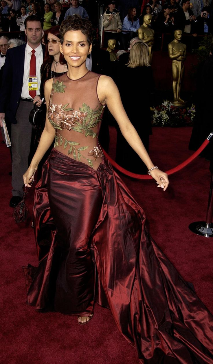 """Halle Berry -- #7: Halle Berry — The actress took home an Academy Award for her performance in """"Monster's Ball"""" at the Oscars in 2002, but it was her strategically-embroidered sheer Elie Saab gown that shocked the world. Though it's not THAT shocking, she certainly wore it well. This design has been included on almost every """"best dressed"""" Oscars list since Berry first wore it. Credit: Steve Granitz/WireImage"""