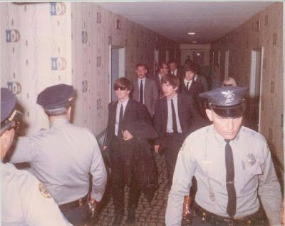 February 1964. The Beatles and their entourage arriving at the Deauville Hotel in Miami Beach.
