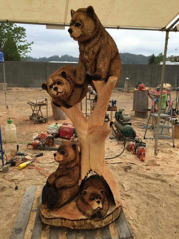 Chain saw carving bear tree
