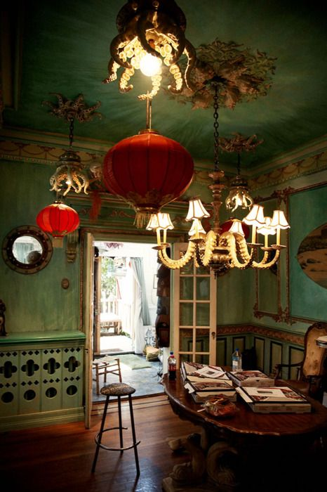 Green room with octopus lighting. From The Kitschy Living tumblr, credited to Adam Wallacavage.