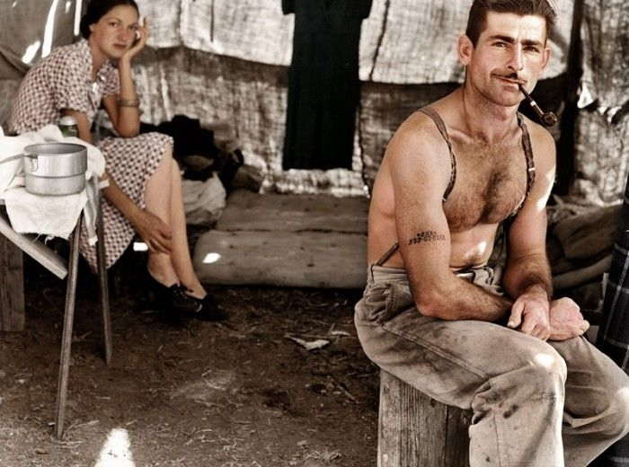 Oregon, August 1939. Unemployed lumber worker goes with his wife to the bean harvest. Note Social Security number tattooed on his arm.