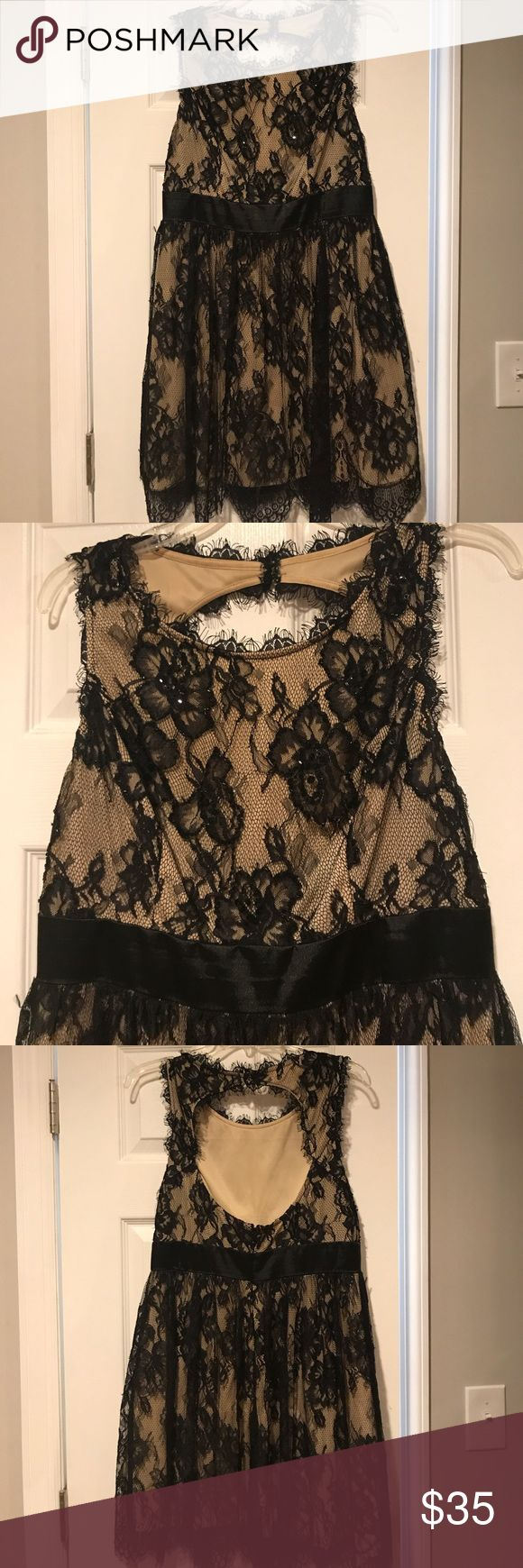 """Betsy Adam dress Worn a few times. Nude with black lace overlay. Keyhole back and black satin band on waist. There is minimal bearing on the top front. It's petite but I am 5'7"""" and the length is perfect - above the knee. Betsy & Adam Dresses"""