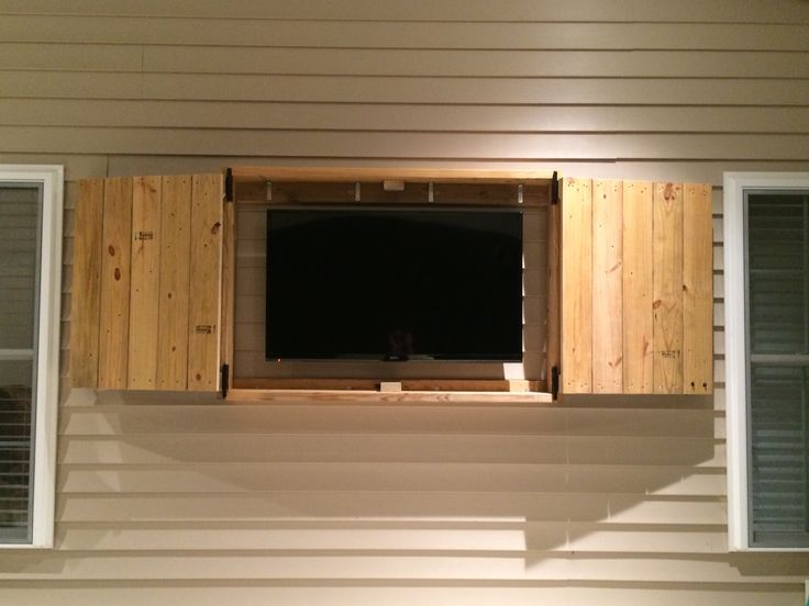 """Downright Simple: Outdoor TV Cabinet for 50"""" TV.  Box Frame is made from pressure treated 2x8. Doors are made from pressure treated decking."""