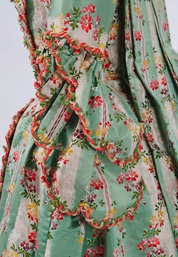 Scalloped edging and fringe fly to sleeves, Robe à la Française, c.1770, Bunka Gakuen Costume Museum, via The Ornamented Being