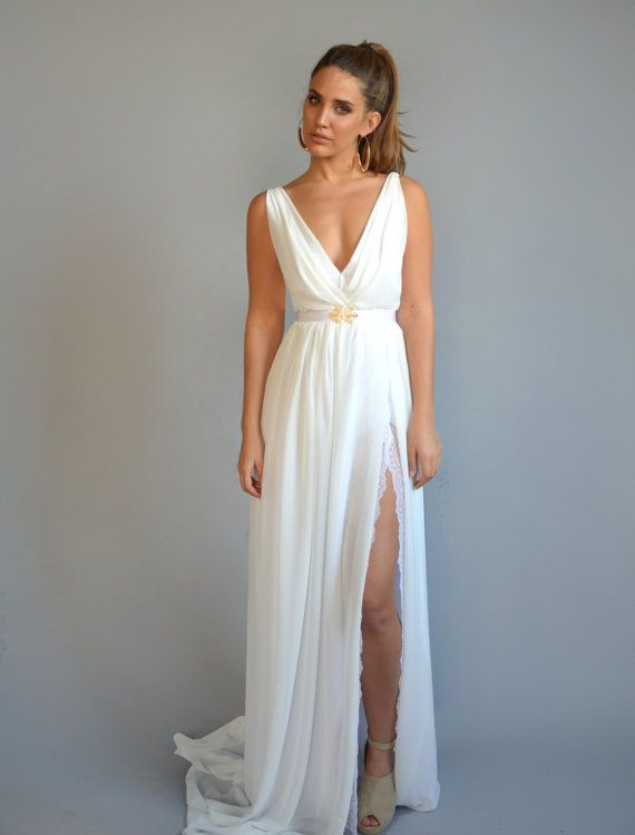 chiffon wedding dress, lace slit wedding dress, V neck wedding dress, open back wedding dress,chiffon wedding dress  This classic broken white boho wedding dress perfect for a beach wedding or a garden wedding with embroidery pattern in cleavage . The romantic and graceful silhouette emphasize feminine shape .   ✦ Standard length of the dress is 143 cm from tip of shoulder to floor- if you want the dress longer just note ✦ Two layers of fabric : chiffon, lining stretch rayon   ✦ It takes me…