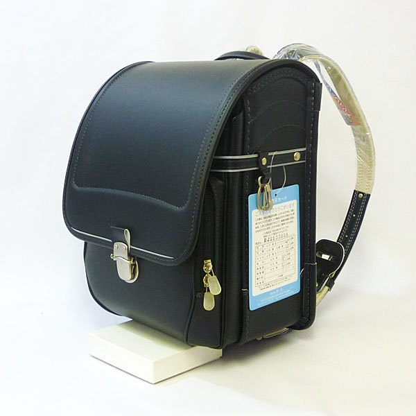 Randoseru - Japanese children's school bag. These sturdy leather bags are expensive (~200 bucks). Traditionally, it's the grandparents' job to purchase one of these bags and a study desk for a grandchild entering elementary school.