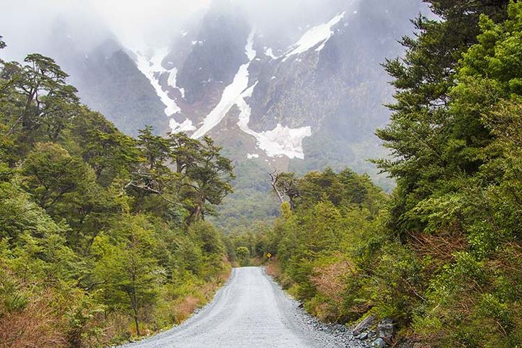 Misty mountains loom above the Carretera Austral. Image by Lucas Brentano / Moment / Getty Images.