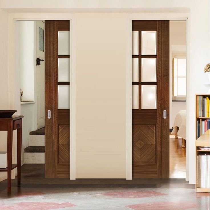 Deanta Unilateral Pocket Kensington Walnut Prefinished Door with Clear Bevelled Safety Glass.      #pocketdoors  #unilateraldoors  #moderninterior  #interiordesign  #doors
