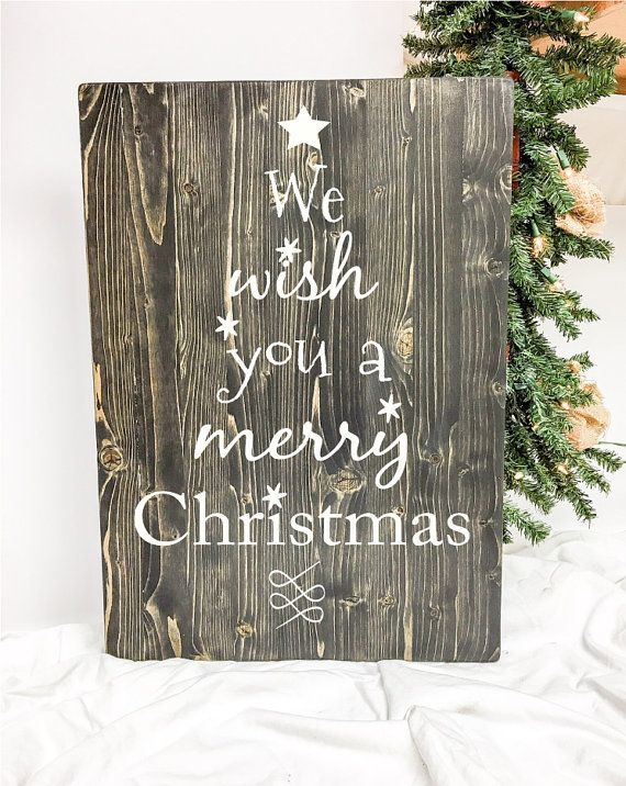 """This cute Christmas themed wood sign features song lyrics from """"We Wish You a Merry Christmas."""" This board has plenty of character with the song lyrics being in the shape of a Christmas tree. This sign is pine & measures 16"""" w x 24"""" h x 3/4 thick. Vinyl letters. Handmade in the USA. We always strive for great customer service. If you have a question or concern about one of our products please don't hesitate to contact us and we will handle it as quickly as possible!  *Please Note*  Wood…"""