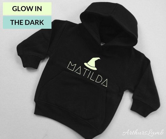 At Halloween little girls love witches, but witchcraft is not just for halloween!! And with this personalised Glow in the Dark Witch Hat hoodie you are sure to stand out!! So whether you are looking for a something to wear when you go out to trick or treat or a Halloween gift, this sweater/jumper personalised with any name will be a much loved addition to the spooky day!! When ordering, please note the name required in Comments to Seller box during checkout. These Black Hoodies with their…