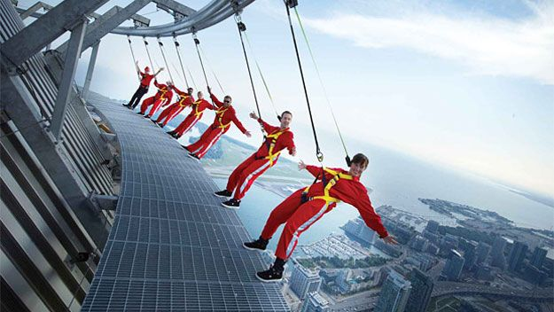 """Hang from Toronto's CN Tower: EdgeWalk—a terrifying """"walk"""" on the I'm-gonna-to-die edge of the ledge of the 1, 800ft-tall CN Tower in Canada. Towering that high (1,168 feet/356m for the EdgeWalk platform) over the grand Toronto harbor, the CN Tower is the world's fifth-tallest free-standing structure."""