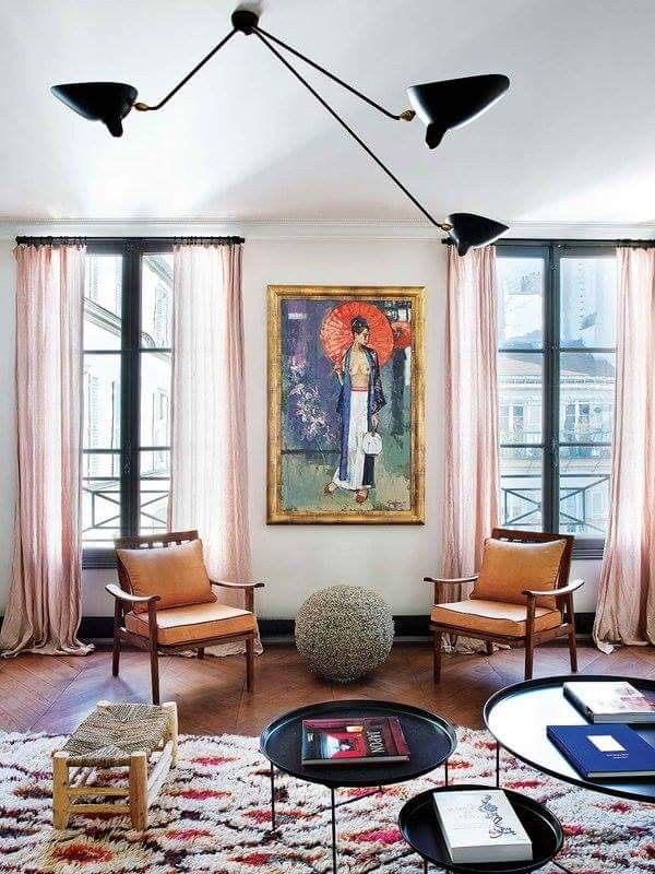 living room arrangements%0A This layered Parisian home is adorned with vintage Berber Moroccan rugs  collected by Caroline Gayral  owner of Fragments in Paris
