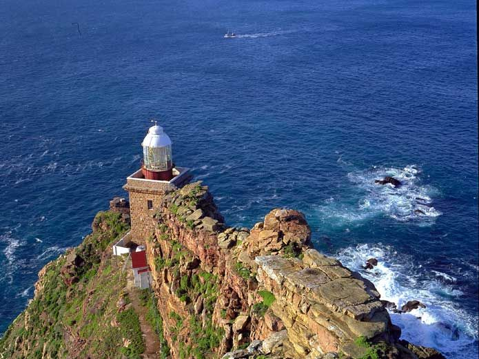 Visit the lighthouse at Cape Point which is part of the Table Mountain National Park in Cape Town, South Africa