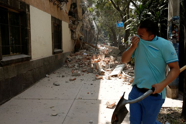 A man reacts near a damaged building after an earthquake hit Mexico City, Mexico September 19, 2017. REUTERS/Carlos Jasso via @AOL_Lifestyle Read more: https://www.aol.com/article/news/2017/09/20/harrowing-video-shows-mexico-city-airport-as-deadly-earthquake-struck/23216869/?a_dgi=aolshare_pinterest#fullscreen