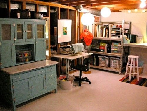 Unfinished basement into an office- love the shelf/hutch would be great for kids storage and books