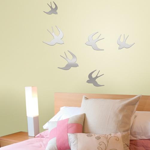 Bird mirror decals on yellow bedroom wall