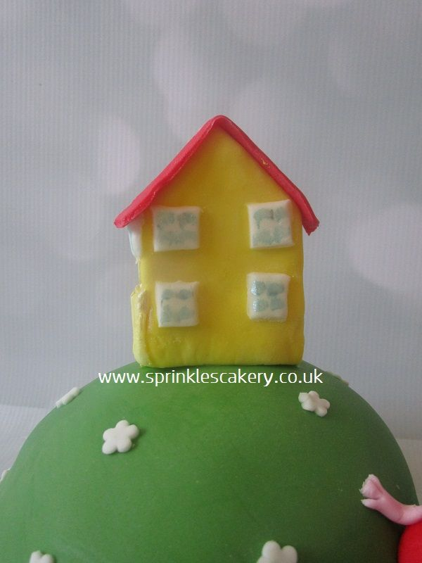 Guess who lives on this cake? A fondant Peppa Pig house.