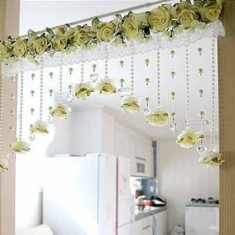 Curtain embellishment used in the doorway for decoration. Nice beads but the roses are indeed too much for me.