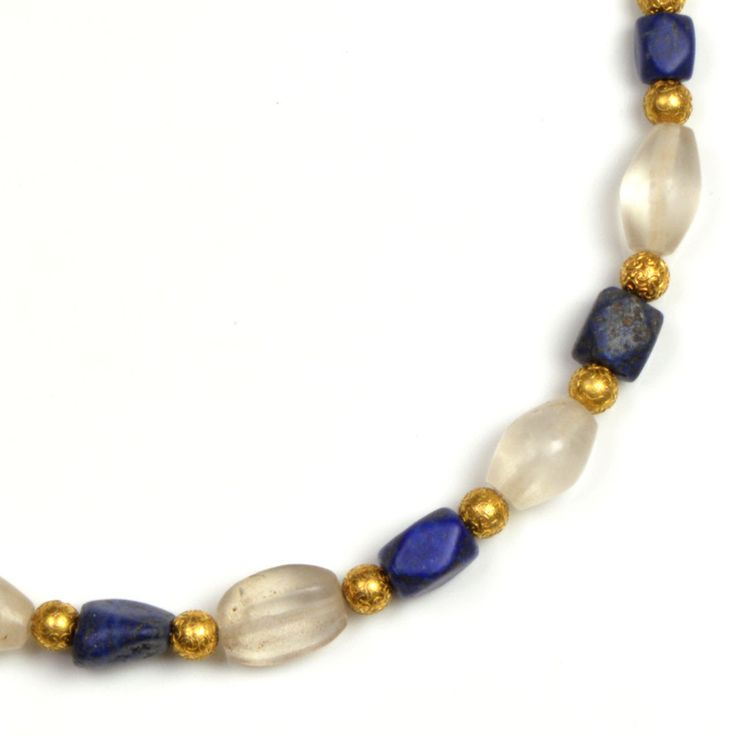 A Western Asiatic Lapis Lazuli and Rock Crystal Necklace, Persian Period, 1st millennium BC