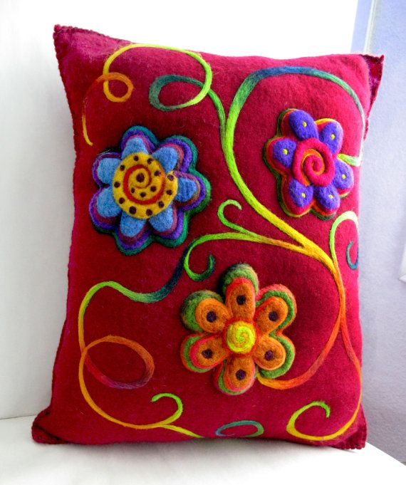 Burgundy felted flower cushion - blanket stitched around the outside with french embroidery cord, needle felted flowers. Nepalese and merino wool.  - by Linda Hoofnagle, hamsterville