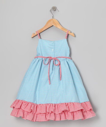 This charming frock will look smartly sweet on any little lady. Kissed with ruffles, a handy back closure and big bow accent, this playful piece is one genius style choice.