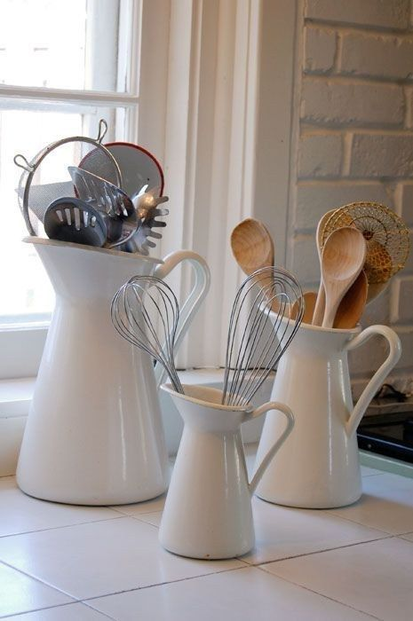 The $19.99 SOCKERÄRT vase is an elegant way to store your kitchen utensils. | 37 Clever Ways To Organize Your Entire Life With IKEA
