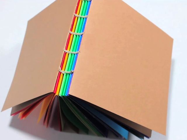 These are exactly the journals I tend to make (minus the rainbow -- I decorate my own pages). Great tutorial from CRAFT mag.