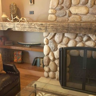 here is an example of extending the mantle to provide an additional element beyond the fireplace