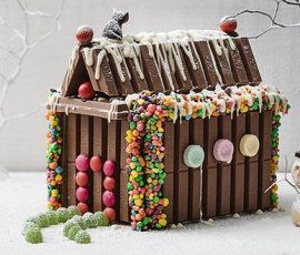 KIT KAT & ALLEN'S Christmas House: This delicious house made with KIT KAT bars and ALLEN'S JAFFAS, Black Cats and JELLY TOTS is sure to impress all your guests!. http://www.bakers-corner.com.au/recipes/kit-kat/kit-kat-christmas-house/