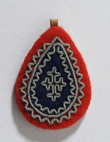 Sweden - Saami, pendant of pewter, leather and wool, c 1962