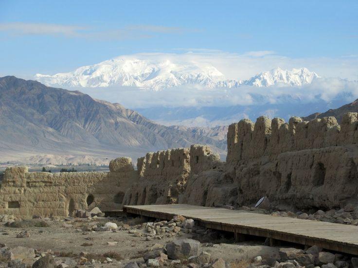 Muztagh Ata (7,509 meters), second highest in the Pamir Range, is visible to the north of the Stone Fort at Tashkurgan, Xinjiang, China