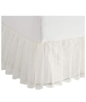 LC Lauren Conrad Tulle Bed Skirt | If the tulle skirt in your closet is a wardrobe staple, consider incorporating something similar into your bedroom decor. This sweet bed skirt will add a subtle touch of femininity to the space and can be made to look dreamy and sophisticated when paired with all-white bedding.